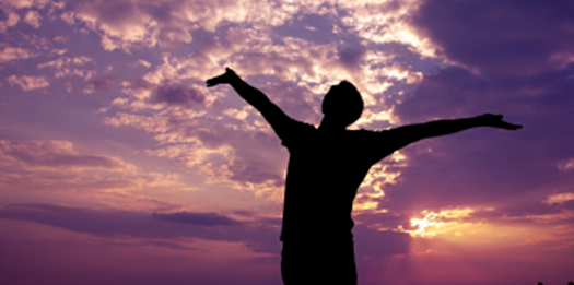 Happy Man against Purple Sunset