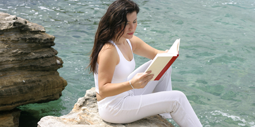 Young Woman Reading Book by Water