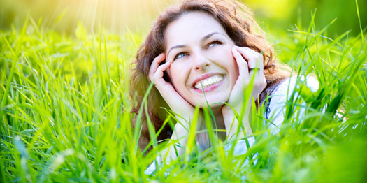 Joyous Woman Who Overcame Anorexia Laying in the Grass