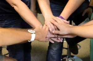 Women's support hands for helping break a Binge Eating Disorder and isolation cycle