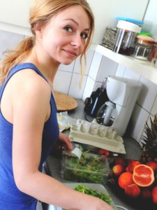 Lady making a meal and learning to Evaluate a Nutrition Program