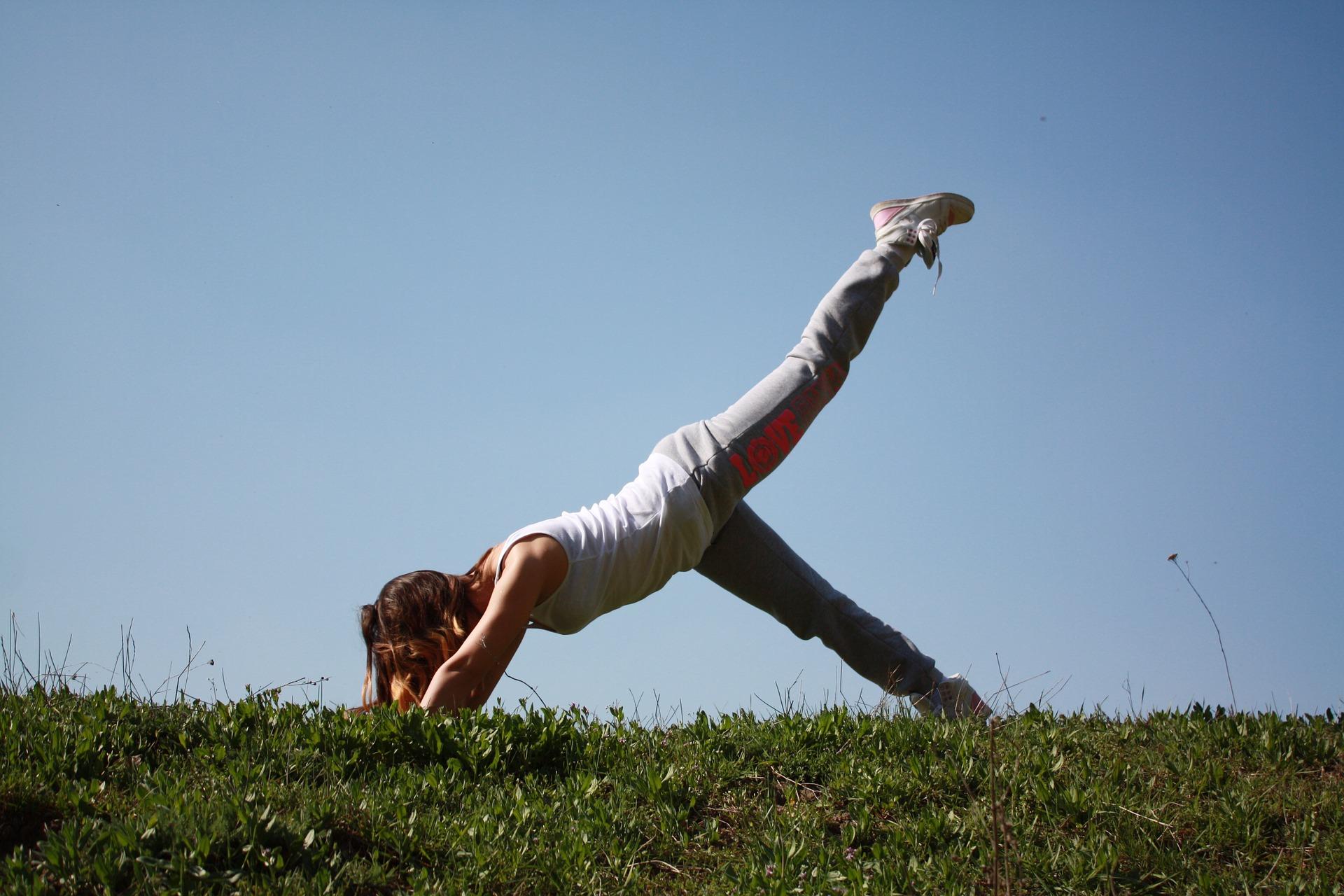 Woman doing yoga for Holistic Health